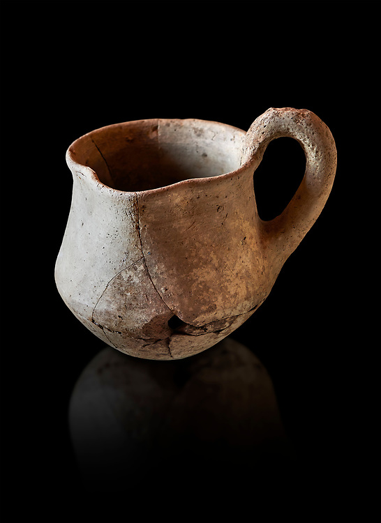 Hittite terra cotta cult side handled spouted jug. Hittite Period 1650 - 1450 BC, Ortakoy Sapinuvwa .  Çorum Archaeological Museum, Corum, Turkey. Against a black bacground. .<br />  <br /> If you prefer to buy from our ALAMY STOCK LIBRARY page at https://www.alamy.com/portfolio/paul-williams-funkystock/hittite-art-antiquities.html  - Ortakoy  into the LOWER SEARCH WITHIN GALLERY box. Refine search by adding background colour, place, museum etc<br /> <br /> Visit our HITTITE PHOTO COLLECTIONS for more photos to download or buy as wall art prints https://funkystock.photoshelter.com/gallery-collection/The-Hittites-Art-Artefacts-Antiquities-Historic-Sites-Pictures-Images-of/C0000NUBSMhSc3Oo