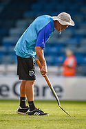 Gillingham head groundsman John Plummer inspecting the new pitch during half-time at the EFL Sky Bet League 1 match between Gillingham and Southend United at the MEMS Priestfield Stadium, Gillingham, England on 13 October 2018.
