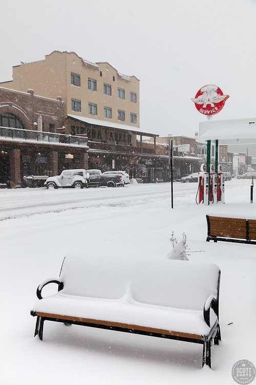 """""""Downtown Truckee 78"""" - Photograph of a snow covered bench in Historic Downtown Truckee, California shot during the day while it was snowing."""