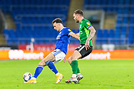 Cardiff City's Mark Harris (29) shields the ball from Birmingham City's Harlee Dean (12) during the EFL Sky Bet Championship match between Cardiff City and Birmingham City at the Cardiff City Stadium, Cardiff, Wales on 16 December 2020.