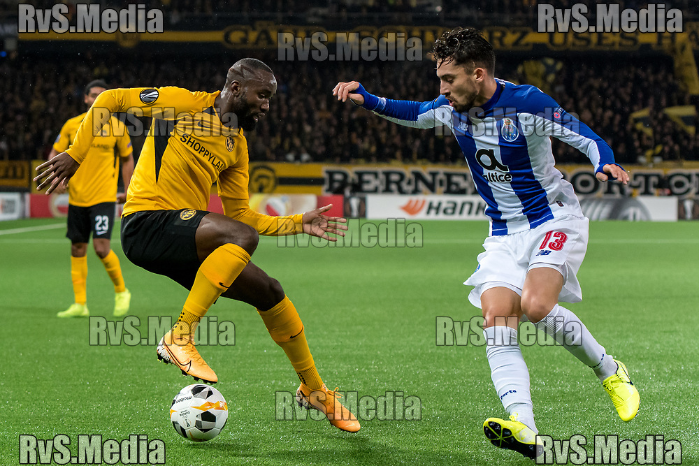 BERN, SWITZERLAND - NOVEMBER 28: #13 Nicolas Moumi Ngamaleu of BSC Young Boys controls the ball in front of #13 Alex Telles of FC Porto during the UEFA Europa League group G match between BSC Young Boys and FC Porto at Stade de Suisse, Wankdorf on November 28, 2019 in Bern, Switzerland. (Photo by Basile Barbey/RvS.Media)