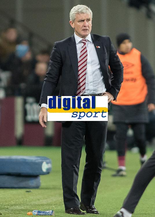 Football - 2016 / 2017 Premier League - West Ham United vs. Stoke City<br /> <br /> Stoke Manager Mark Hughes at The London Stadium.<br /> <br /> COLORSPORT/DANIEL BEARHAM