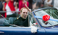 Britain's Prince William and his wife Kate, Duchess of Cambridge ride ride in a vintage Aston Martin on the way to Clearence Houce from Buckingam Palace, after the Royal Wedding in London Friday, April, 29, 2011. (AP Photo/Bogdan Maran)