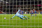Brice Samba (30) of Nottingham Forset dives at the ball as David Brooks (7) of AFC Bournemouth shoots at goal during the EFL Sky Bet Championship match between Bournemouth and Nottingham Forest at the Vitality Stadium, Bournemouth, England on 24 November 2020.