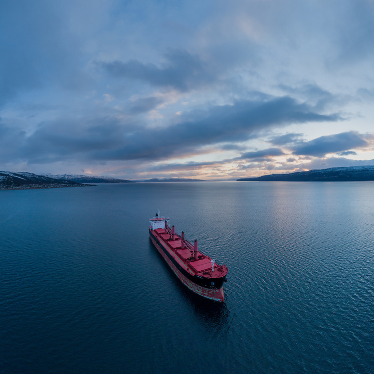 Aerial view of the bulk carrier 'Kumpula' anchored in the Ofot fjord in Narvik of Northern Norway.