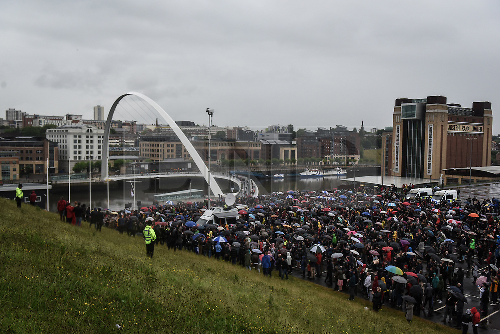 © Licensed to London News Pictures. 05/06/2017. Newcastle Upon Tyne, UK.  Hundreds of people wait in carparks, unable to gain entry to the Sage Gateshead, due to the numbers who arrived to listen to Jeremy Corbyn MP, Leader of the Labour Party as he speaks to his supporters. Mr Corbyn spent one of the final days of the campaign trail in the Labour heartlands of North-East England before voters go to the polls in the UK General Election on June 8th 2017. Photo credit: MARY TURNER/LNP
