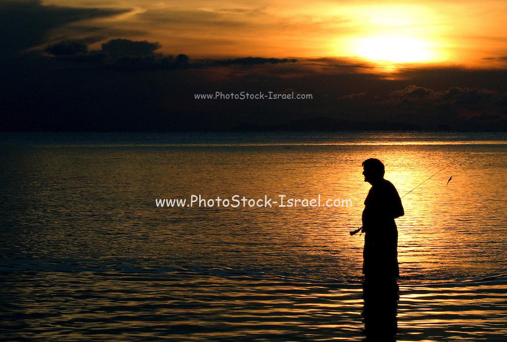 local fisherman at sun set Koh Phangan Thailand