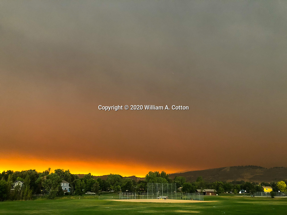 Smoke from the Cameron Peak Fire darkens the sky over Fort Colllins, September 7, 2020.