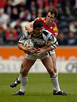 Photo: Jed Wee.<br /> Hull v Wigan Warriors. Engage Super League. 30/04/2006.<br /> <br /> Wigan's Pat Richards (R) tries to tackle Hull's Shayne McMenemy.