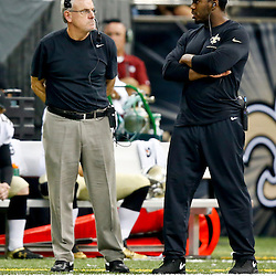 Sep 22, 2013; New Orleans, LA, USA; New Orleans Saints linebackers coach Joe Vitt (left) and linebacker Jonathan Vilma (right) currently on injured reserve on the sideline during a game against the Arizona Cardinals at Mercedes-Benz Superdome. The Saints defeated the Cardinals 31-7. Mandatory Credit: Derick E. Hingle-USA TODAY Sports
