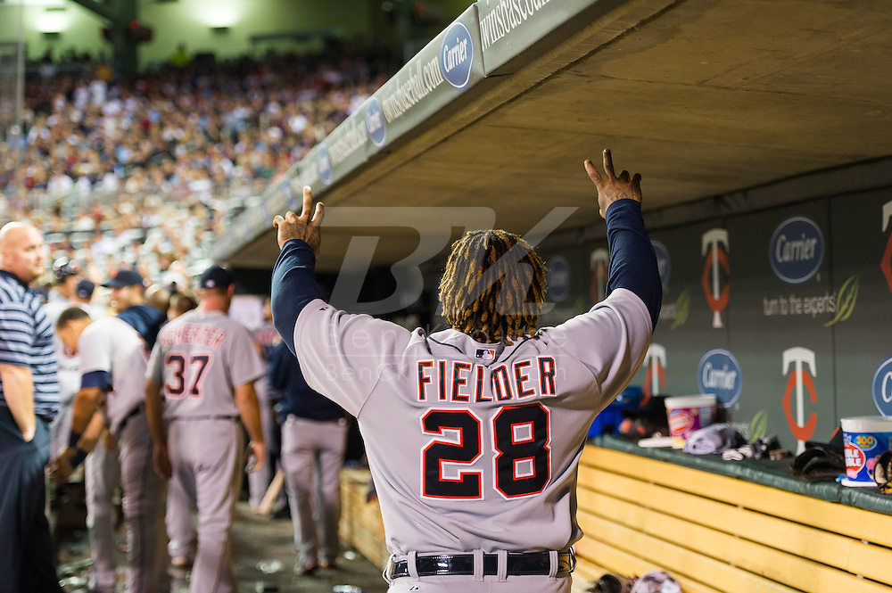 Prince Fielder (28) of the Detroit Tigers celebrates after teammate Andy Dirks (12) hit a home run during the sixth inning against the Minnesota Twins on August 14, 2012 at Target Field in Minneapolis, Minnesota.  The Tigers defeated the Twins 8 to 4.  Photo: Ben Krause