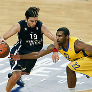 Anadolu Efes's Sasha VUJACIC (L) and Maccabi Tel Aviv's Keith LANGFORD (R) during their Turkish Airlines Euroleague Basketball Group C Game 4 match Anadolu Efes between Maccabi Tel Aviv at Sinan Erdem Arena in Istanbul, Turkey, Thursday, November 10, 2011. Photo by TURKPIX