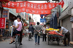 Busy traditional street in an old district of Beijing China