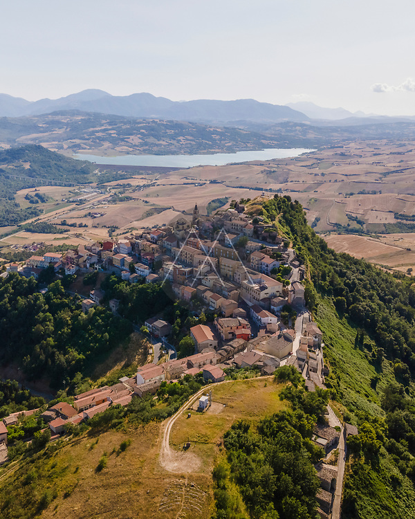 Aerial view of Cairano from above, a small township on hilltop surrounded by countryside, Irpinia, Avellino, Italy.