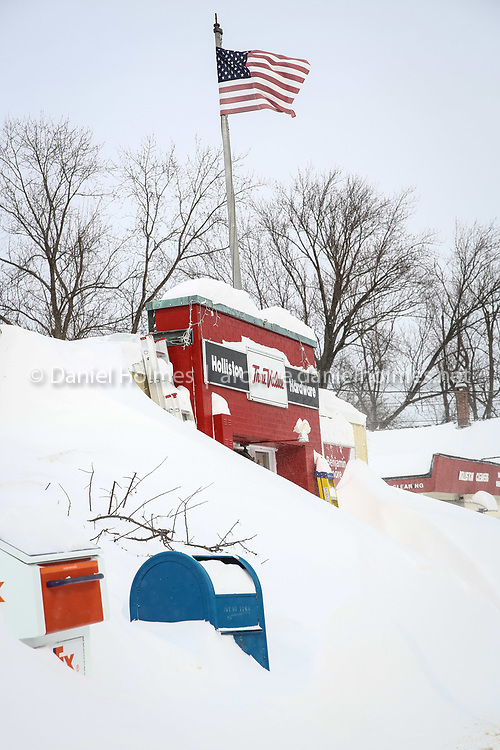 (2/15/15, HOLLISTON, MA) Snow nearly obscures Holliston Hardware during the latest snow storm to hit the area on Sunday. Daily News and Wicked Local Photo/Dan Holmes