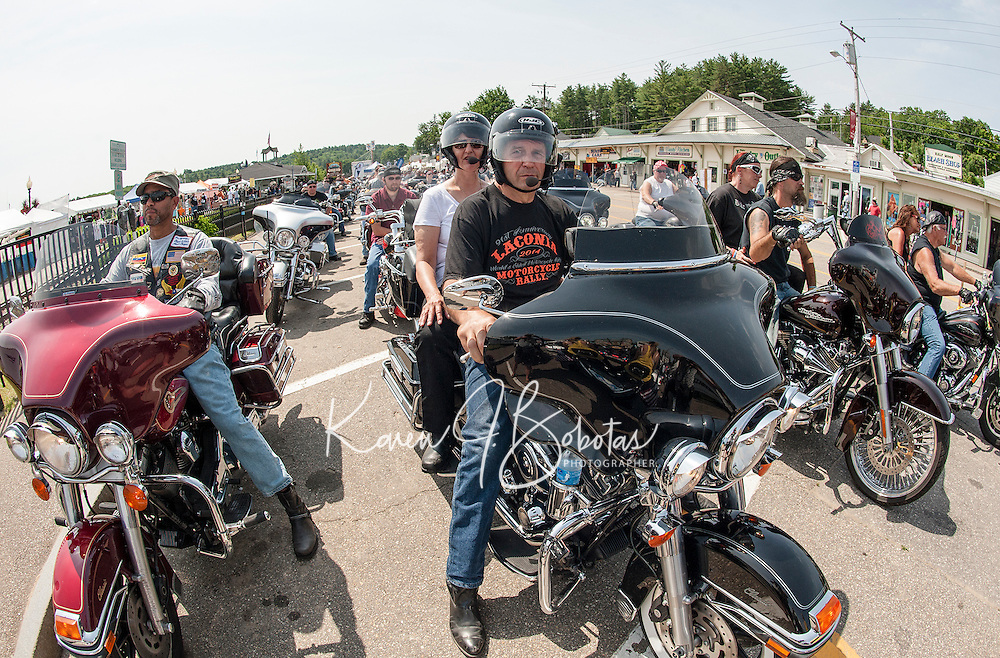 1Motorcyclists gather along Lakeside Avenue at Rally Headquarters for a group ride to Arundel Maine on Tuesday during Laconia's 91st Motorcycle Rally.  (Karen Bobotas/for the Laconia Daily Sun)