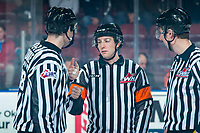 KELOWNA, BC - JANUARY 3: Referee Trevor Nolan stands on the ice speaking to line officials Cade Cooke and  Brett Mackey at the Kelowna Rockets against the Victoria Royals at Prospera Place on January 3, 2020 in Kelowna, Canada. (Photo by Marissa Baecker/Shoot the Breeze)