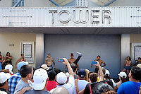 MIAMI - MARCH 9, 2014: People watching live street performers during the 37th Calle Ocho festival, an annual event that takes place over Eight Street in Little Havana featuring plenty of music, food, and  it is the biggest party in town that celebrates hispanic heritage.