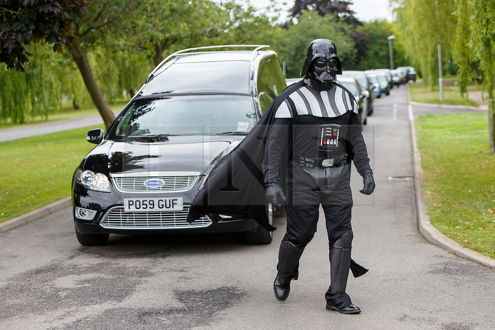 © Licensed to London News Pictures. 15/07/2015. Luton, UK. Lorna Johnson's halloween themed funeral takes place at Luton Crematorium in Luton on Wednesday, July 15, 2015. Lorna Johnson, 56 year old full time mother, loved halloween, fancy dresses and Star Wars and her family has requested that friends and family to attend her funeral wearing fancy dress. The Funeral Director, Brett Houghton of Co-op Funeralcare dressed up as Star Wars' Darth Vader. Photo credit: Tolga Akmen/LNP