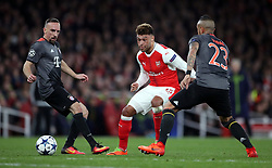 Arsenal's Alex Oxlade-Chamberlain battles for the ball with Bayern Munich's Arturo Vidal (right) and Franck Ribery during the UEFA Champions League Round of 16, Second Leg match at the Emirates Stadium, London.