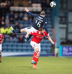 Dundee's David Clarkson over Ross County's Richard Brittain.<br /> Half time : Dundee 0 v 0 Ross County, SPFL Premiership game player 4/1/2015 at Dundee's home ground Dens Park.