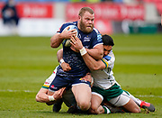 Sale Sharks hooker Akker Van Der Merwe is held by London Irish Centre Curtis Rona during a Gallagher Premiership Round 14 Rugby Union match, Sunday, Mar 21, 2021, in Eccles, United Kingdom. (Steve Flynn/Image of Sport)