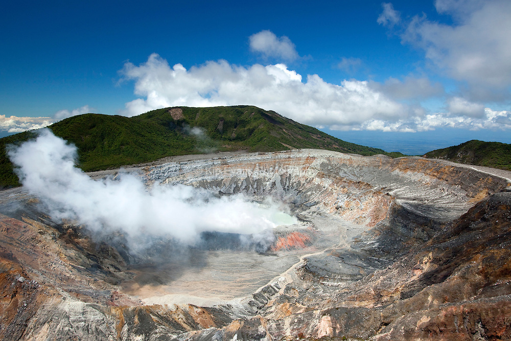 At the edge of an active crater volcano in Poas Volcano National Park in Costa Rica.