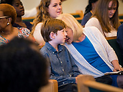 26 MAY 2019 - WATERLOO, IOWA: US Senator KIRSTEN GILLIBRAND (D-NY) talks to her son, HENRY GILLIBRAND, 11, at Mt. Carmel Missionary Baptist Church in Waterloo Sunday. Sen. Gillibrand is on her 5th trip to Iowa this week to support her candidacy to be the Democratic nominee for the US Presidency. Iowa traditionally hosts the the first selection event of the presidential election cycle. The Iowa Caucuses will be on Feb. 3, 2020. Mt. Carmel Missionary Baptist Church was established in 1921 and is the third oldest African-American church in Waterloo. Waterloo has the largest African-American community in Iowa.             PHOTO BY JACK KURTZ
