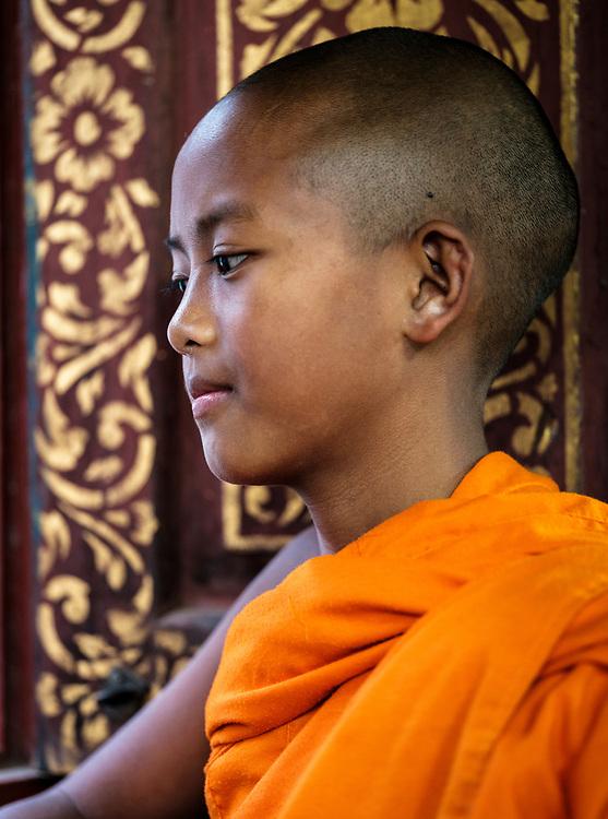 KYAING TONG, MYANMAR - CIRCA DECEMBER 2017: Portrait of young Monk at the Wat Jong Kham Monastery.