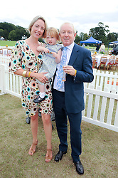 SIMON & REBECCA BREWER and their daughter TABITHA at the Veuve Clicquot Gold Cup polo final held at Cowdray Park, Midhurst, West Sussex on 18th July 2010.
