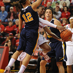 Rutgers Scarlet Knights guard Erica Wheeler (3) puts up a basket between West Virginia Mountaineers guard Vanessa House (12) and guard Liz Repella (10) during first half Big East NCAA women's basketball action between Rutgers and West Virginia at the Louis Brown Rutgers Athletic Center