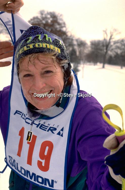 Woman age 54 at cross country ski race at Lake Phalen.  St Paul  Minnesota USA