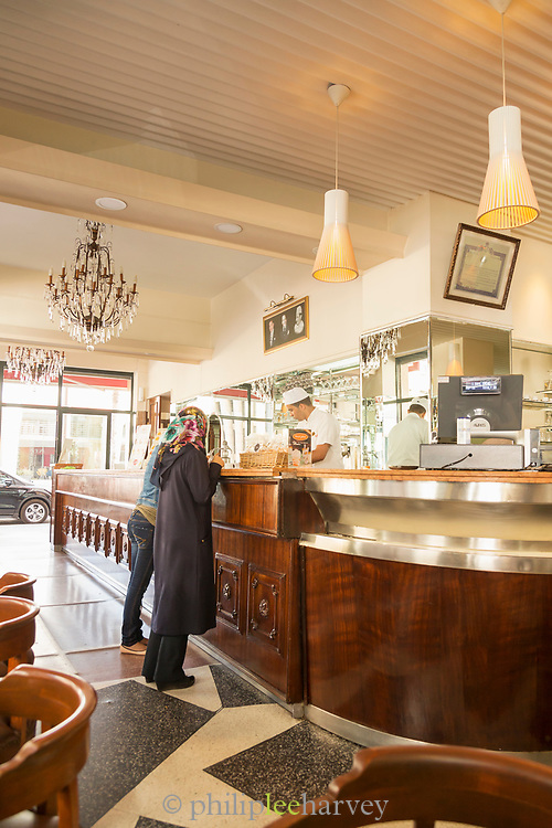 Customers standing in bar on bright sunny day, Casablanca, Morocco