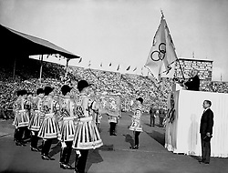 The Lord Mayor of London holding the Olympic flag after he received it for safe keeping until the next Olympics.