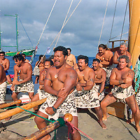 Cook Islanders aboard a vaka (traditional canoe), part of the peace flotilla outside the 12 mile exclusion zone around the French nuclear test site Moruroa, perform a Haka in protest against nuclear tests. Moruroa, South Pacific.