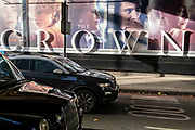 A panoramic billboard advertising the latest series of Netflix's 'The Crown' which is now airing on demand, shows the main characters of the British royal family - and featuring the relationship and romance between Prince Charles and Diana, Princess of Wales, on 12th November 2020, in London, England.