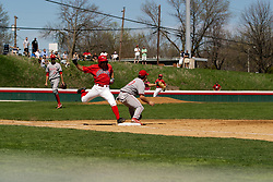 15 April 2006:  ISU's Jay Molina takes a long stride but is called out as Bradley's first baseman Jason Newburger pulls in the throw. Bradley University Braves are defeated in game one of a double header against the Illinois State University Redbird at Redbird Field in Normal IL.