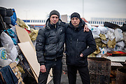 "Activists Andrej (right) and his brother at the barrikades blocking a building supplies store named ""Epicenter"" in the city of Lviv, Ukraine."