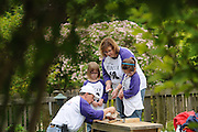 Nicor Inc. employees and their families attend the company's 14th annual Volunteer Day at Brookfield Zoo in Brookfield, Il. Participants assembled and painted birdhouses and enjoyed a tour of the zoo while learning about the benefits of volunteering time in their communities.
