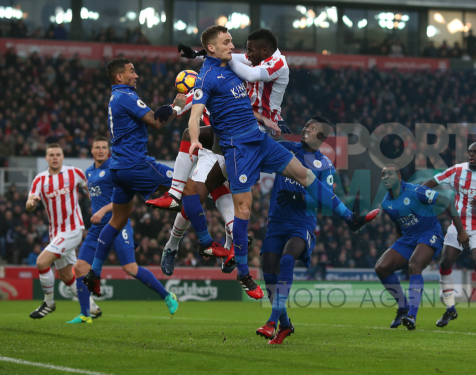 Players tangle in the box during the English Premier League match at the Bet 365 Stadium, Stoke on Trent. Picture date: December 17th, 2016. Pic Simon Bellis/Sportimage