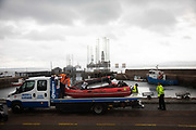 Greenpeace activists board a BP oil rig in Cromarty Firth to stop it from further oil drilling at sea, June 10th 2019, Cromarty, Scotland, United Kingdom. The oil rig Paul B. Loyd, Jnr, owned by Transocean, was due to head to BPs Vorlich field, 150 miles 241km east of Aberdeen to drill for oil for BP. A Greenpeace rhib is taken away. The occupation by Greenpeace activists subsequently delayed the departure for 5 days and 14 activists were arrested in the process. Greenpeace says that in an age of climate emergency BP should not be drilling for new oil but look for non-fossil fuel means of energy.