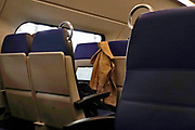 Nederland, Nijmegen, 5-3-2019In een trein coupe tweede klas is een passagier bezig op een laptop.Foto: Flip Franssen