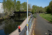 Local response to Coronavirus is felt on a street by street level as people exercise along the many canals of the waterways system and specifically here on the Birmingham Canal Old Line in Ladywood on 15th April 2020 in Birmingham, England, United Kingdom. Coronavirus or Covid-19 is a new respiratory illness that has not previously been seen in humans. While much or Europe has been placed into lockdown, the UK government has put in place more stringent rules as part of their long term strategy, and in particular social distancing.