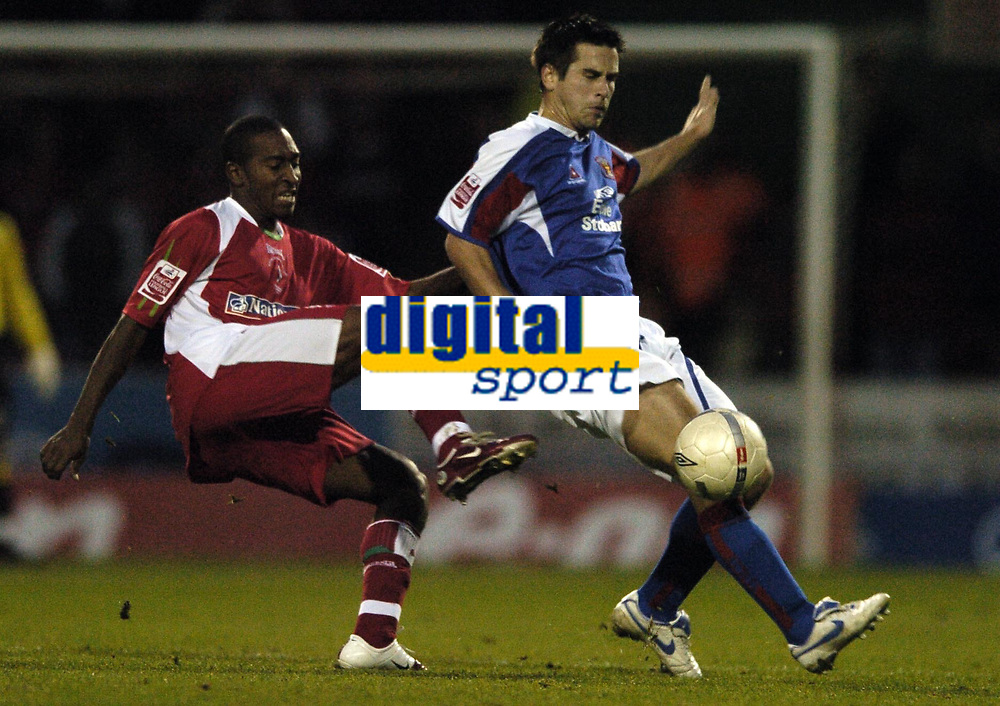 Photo: Jonathan Butler.<br />Swindon Town v Carlisle United. The FA Cup. 11/11/2006.<br />Ricky Shakes of Swindon passes pasted Kevin Gail of Carlisle.