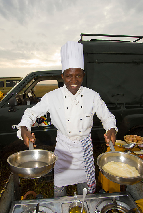 A chef prepares breakfast after a hot air balloon landing (Transworld Safaris) in Masai Mara National Reserve, Kenya