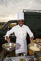 A chef prepares breakfast after a hot air balloon landing (Transworld Safaris) in Masai Mara National Reserve, Kenya