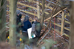 "© Licensed to London News Pictures. 11/12/2019. Gerrards Cross, UK. Forensic investigators look over the search area in Gerrards Cross, Buckinghamshire as Metropolitan Police Service continue to search woodland. Police have been in the area conducting operations since Thursday 5th December 2019. In a press statement issued on 7th December, a Metropolitan Police spokesperson said ""Officers are currently in the Gerrards Cross area of Buckinghamshire as part of an ongoing investigation.<br /> ""We are not prepared to discuss further for operational reasons."" Photo credit: Peter Manning/LNP"