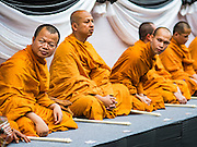26 NOVEMBER 2016 - BANGKOK, THAILAND:  Buddhist monks prepare to lead a prayer for the late king of Thailand. Thousands of people gathered on Yaowarat Road in the heart of Bangkok's Chinatown to honor Bhumibol Adulyadej, the Late King of Thailand. The event was organized by the Thai-Chinese community and included a performance by the Royal Thai Navy orchestra of music composed by the Late King, a prayer by hundreds of Buddhist monks. It concluded with a candlelight vigil. The King died after a long hospitalization on October 13. The government has declared a one year mourning period. HRH Crown Prince Maha Vajiralongkorn, the Heir Apparent and Late King's son, is expected to be name the King next week. He will be known as Rama X.      PHOTO BY JACK KURTZ