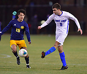 St. Louis University forward Stefan Stojanovic shoots on goal as University of Missouri - Kansas City player Aiden Cavanaugh moves in to block his shot. St. Louis University played the University of Missouri - Kansas City in men's soccer on February 3, 2021 at Robert Hermann Stadium on the SLU campus in St. Louis, MO.<br /> Tim Vizer/For the Post-Dispatch