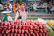 Mar 22, 2009 -- A blind woman sells fruit in the Wong Wian Yai train station in Thonburi. The Mahachai Rail Line is a commuter line that runs from the Wong Wian Yai train station in the Thonburi section of Bangkok to the fishing port and market town of Samut Sakhon, which used to be known as Mahachai. A second line from Baan Laem to Samut Songkhram, another fishing port south of Samut Sakhon. Each stretch of the line takes about an hour.    Photo by Jack Kurtz